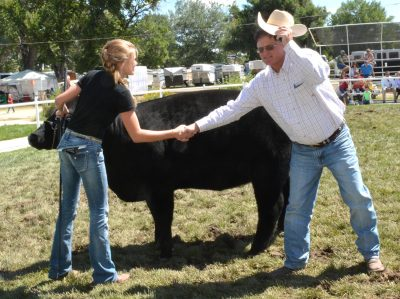 Photograph of girl, her beef entry, and the judge.