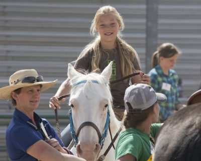 4-H'er is riding a horse