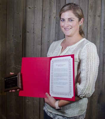 Picture of woman holding plaque