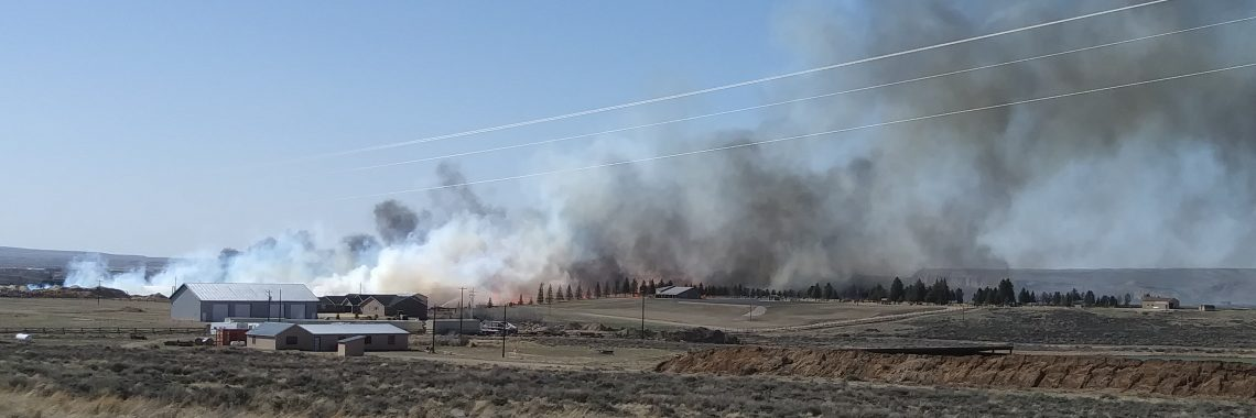 Fire and smoke on the range as seen from a distance.