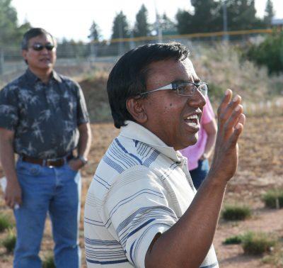 Man speaking in field