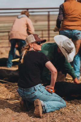 Girl kneeling down with calf