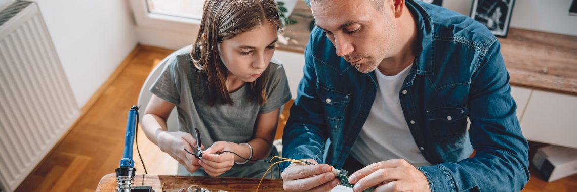 Father and daughter working on STEM project.