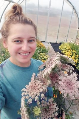 Photograph of student holding flowers