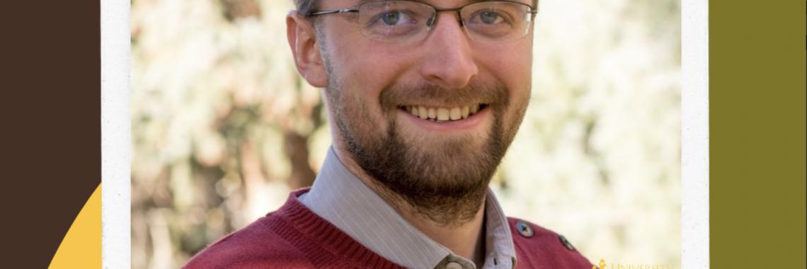 Man smiling in glasses