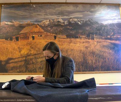Individual examining wool product