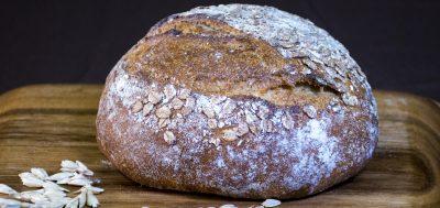 round bread loaf on wood cutting board