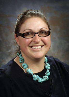 Girl in glasses smiling