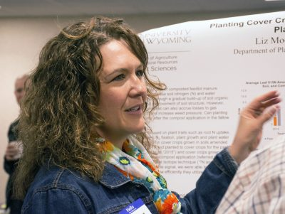 Women pointing to research poster