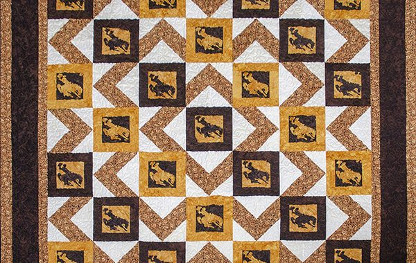 University of Wyoming, brown and gold quilt