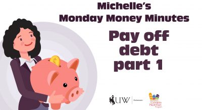 How to pay off debt with Michelle holding an oversized piggy bank.