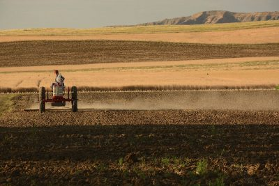 Tractor harrowing field
