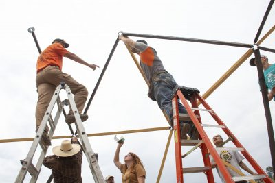 People assembling wooden structure