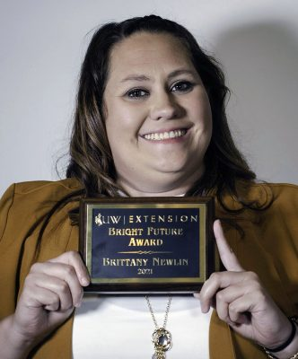 Women holding plaque